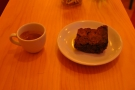 A very poor picture of my very good espresso and delicious brownie.