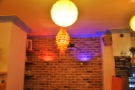 Pretty light-fittings and a bare brick wall.