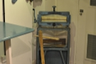 The laundry theme is continued with this mangle. And the line of drying socks... I last time I saw a mangle was at my grandmother's (where it was still in use) over 30 years ago.