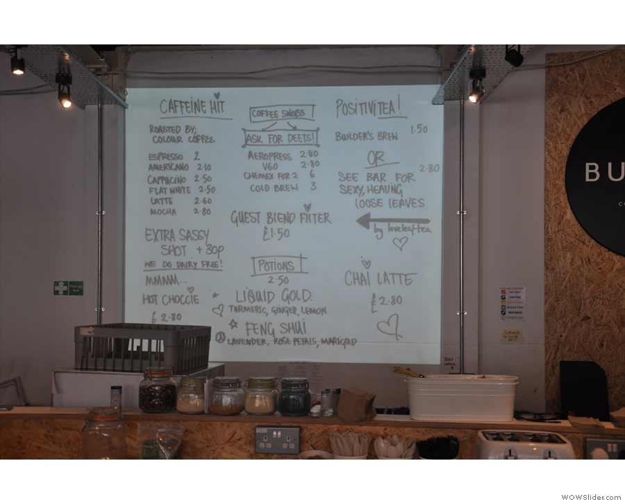... while the menu is projected on a screen behind the counter (interspersed with adverts).